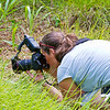 Josie taking macro picture of cricket. - Josie talking macro pictures in rainforest.