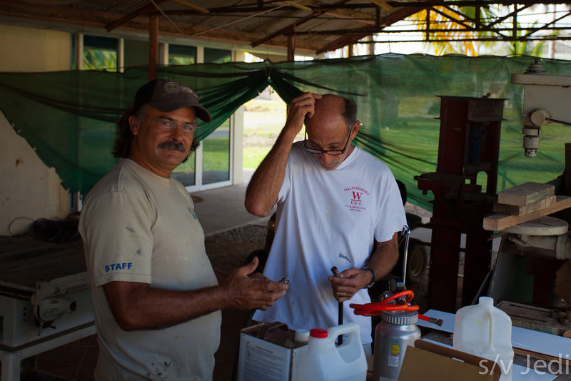 Ramon and Steve figuring out a new spray gun.