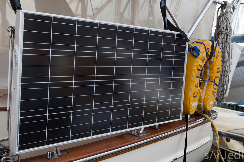 Solar panel mounted on stanchions of sailboat.