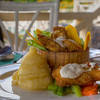 Banana Fish. - Banana Fish is the signature dish of the Los Lagartas restaurant on the banks of the Rio Chagres at the Gamboa Rainforest Resort. This dish is freshly caught snook fried in a musterd batter and served with steamed vegatables and mashed potatoes.