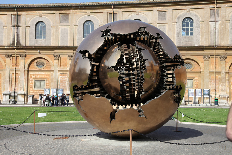 "In the Vatican Museum now... this modern sphere sculpture slowly spins (e.g., search youtube for ""vatican sphere sculpture"")"