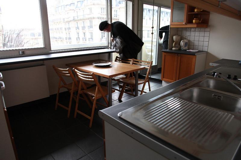 Kitchen & dining room.  John couldn't easily get the balcony door shut.
