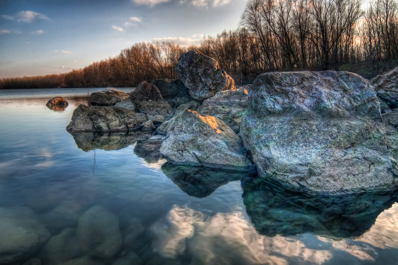 Blue Rocks  Rocks have such a nice texture in HDR. And if I can find a reflection to go with that, that's a great photo for me :)  HDR from three shots, taken with Canon 450D with Sigma 10-20mm lens from a tripod. Photo taken at the Cunovo Dam near Bratislava.