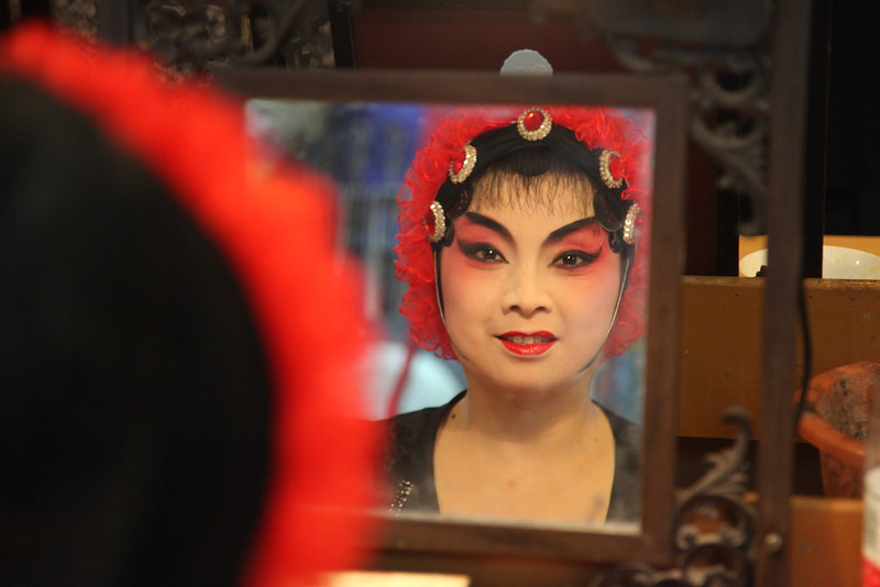 In the make-up room before going on stage at the Chinese Opera. This actress posed for me after a gave her my best Ni hau. Chengdu.