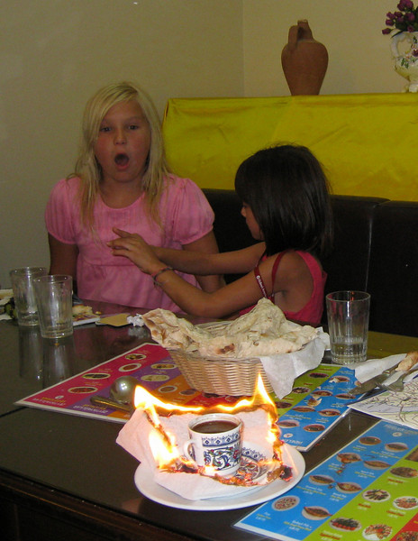 A turkish coffee, served complete with flaming napkin.<br /> (Caroline Aoki & Zoe LaPoll)
