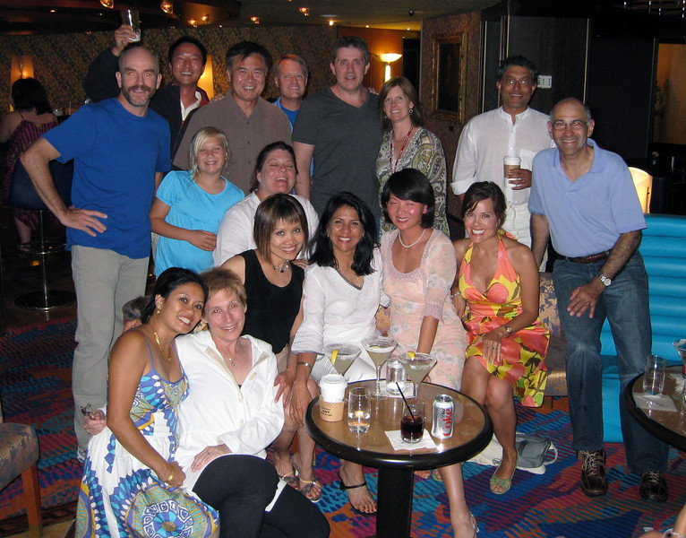 The (mostly adult portion of the) gang for the '08 cruise.  <br /> <br /> Front row (l to r): Myla LaPoll, Esther Schorr, Ngoc Phan, Anita Bhagat, Felicity Kuo, and Michele Kirsch (Steve not present for picture).  <br /> Middle row: Caroline and Peggy Aoki.  <br /> Back row: Dave Beyer, Howard Kuo, Don Aoki, Francis LaPoll, Jeff Winner, Stephanie Winner, Arjun Bhagat, Andrew Schorr.