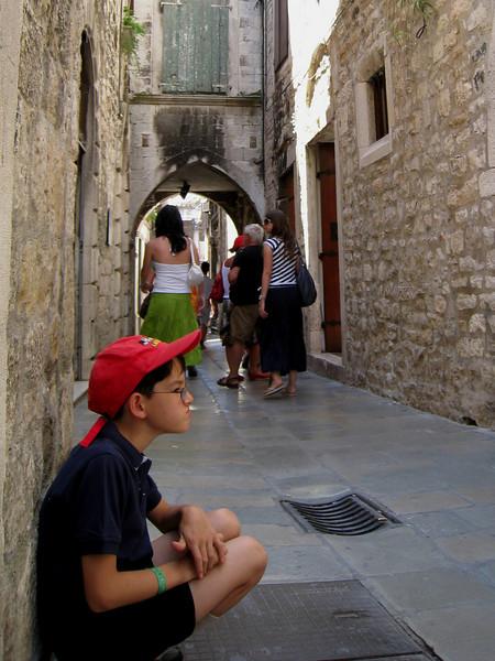 Taking a break along an ooolld wall in Split Croatia.