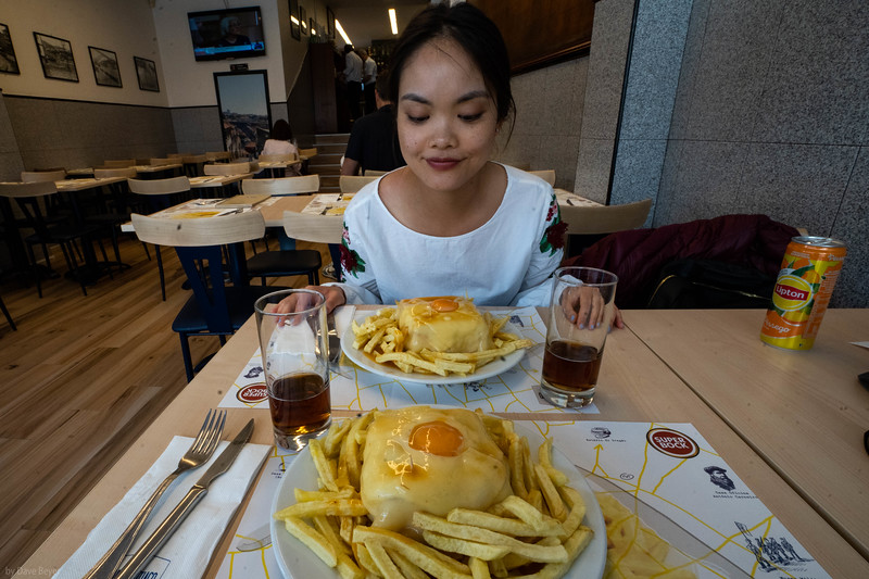 "Straying far from my usual diet reservation, the mighy ""Francesinha,"" Porto's carnivorous decadence of bread, ham, spiced sausage, roast beef, cheese, tomato-beer sauce, topped with a fried egg, and always accompanied by french fries."