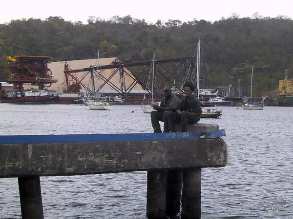 Cruising Trinidad: Peake's yard<br /> John and a co worker at Peakes boatyard in Trinidad.