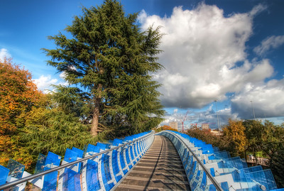 Blue walkway in Coventry  What a nice day it was. I took this close to the end of October 2010. It was really warm and sunny :). This walkway is right next to a big transport museum in Coventry, Uk. I really regret that I went there without a tripod. I have many photos, but very few good ones. But there definitely will be another visit one day :)  HDR from three shots, taken with Canon 450D with Sigma 10-20mm lens, handheld.