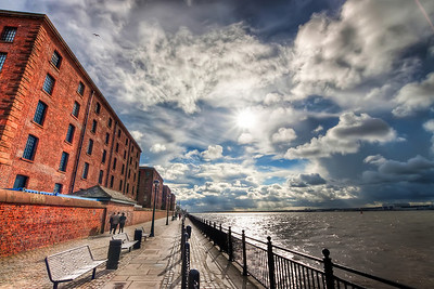 Clouds over Albert dock  Ok. Enough with Prague at least for few days :) So back to Liverpool :). This shot was taken in October last year. It looks like there was a nice weather from this photo, but in reality it was very cold. The sun came out like this only for few minutes.   HDR from three shots, taken with Canon 450D with Sigma 10-20mm lens, handheld.