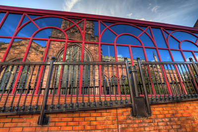 In Reflection  I think I see reflection everywhere (without even searching for them :) ). I took this shot, while walking through Coventry, UK. It was a nice sunny day, and the windows on the building opposite the Holy Trinity Church were so clean :)  HDR from three shots, taken with Canon 450D with Sigma 10-20mm lens, handheld.