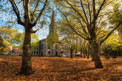 St. Pauls Church in Autumn  As I said, currently my camera is in repair, so I'm editing my older photos. This one is from last October, when I was in Birmingham UK. I took this only handheld, but as there was not that much wind that day, it aligned quite nicely.   HDR from three shots, taken with Canon 450D with Sigma 10-20mm lens, handheld.
