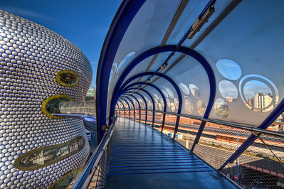 Selfridges Walkway  Second shot taken at the Selfridges in Birmingham, UK. This is one really strange building :)  HDR from three shots, taken with Canon 450D with Sigma 10-20mm lens, handheld
