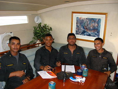 IMG_1104.JPG Cruising Monjes del Sur. Four of the five Coast Guards who came aboard in Des Monjes. Not that they needed five but they all want to visit the new boats that arrive. They say it is for inspection but they really just want to talk and get to know you.