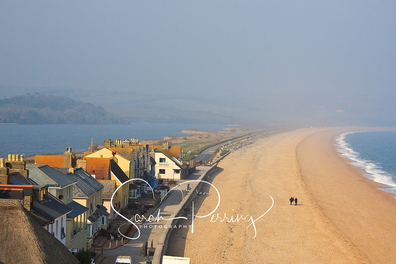 Looking down at Torcross beach and Slapton Ley with mist in the background