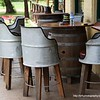 Chairs and a table outside the Beehive Hotel in Coolac, NSW in December 2017. The table tops rests on a keg and the chairs have backs sculpted out of a tin drum. Very rustic