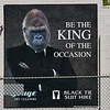 Giant poster of a gorilla in a suit advertising Black tie suit hire in Albury in December 2017. Be the king of the occasion