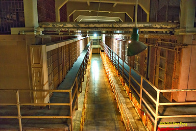 The view from the east gun gallery.  The gallery guard had an unobstructed view of the length of the cell block all the way to the west gun gallery in the background.  In addition, he can move into the D block and see what is going on there  by going through a metal door from the main cellblock.