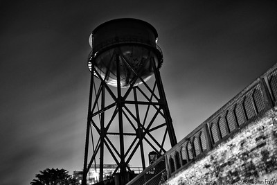 The water tower glows at night from the light in the main cellblock .
