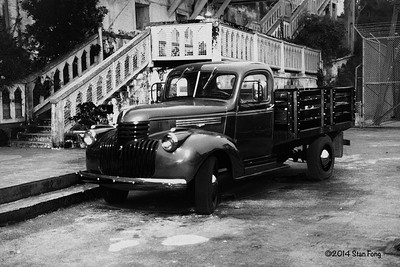 A vintage Chevy truck which was used for a movie filmed on Alcatraz stands in front of the dock.