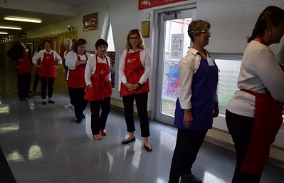 Volunteers wait in line to become a personal shopper for the children during Operation School Bell at Alcott Elementary School on Thursday, Oct. 13, 2016.