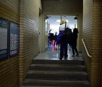 Students are walked back to their classroom and teacher after shopping during Operation School Bell at Alcott Elementary School on Thursday, Oct. 13, 2016.