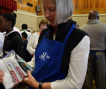 Carol Murphy, vice president of philanthropy for the Assistance League of Southeastern Michigan, with one of the hygiene kits given to students during Operation School Bell at Alcott Elementary School on Thursday, Oct. 13, 2016.