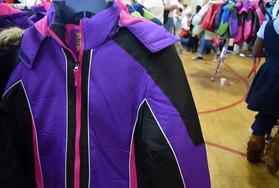Brand new winter coats ready to find a new home with the kids at Operation School Bell at Alcott Elementary School on Thursday, Oct. 13, 2016.