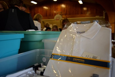 White uniform shirts kept clean in packaging during Operation School Bell at Alcott Elementary School on Thursday, Oct. 13, 2016.