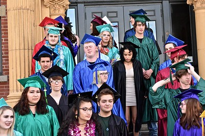 It was a mix of emotions as students wait for their official photograph in front of the Morris Graves Museum of Art. José Quezada—For Times-Standard