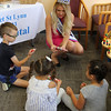 Lynn, Ma. 9-14-17. Mrs Massachusetts Anna Svetchnikov hands out tooth brushes to Vlad Klimov, Biranna Spatafore, and Kaitlin Vasquez at the back to school open house at Alegre Dental Center.