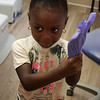 Lynn, Ma. 9-14,17. Makhilah Wright-Hopkins got to try on some dentist gloves at the back to school open house held at Alegre Dental Center in Lynn.