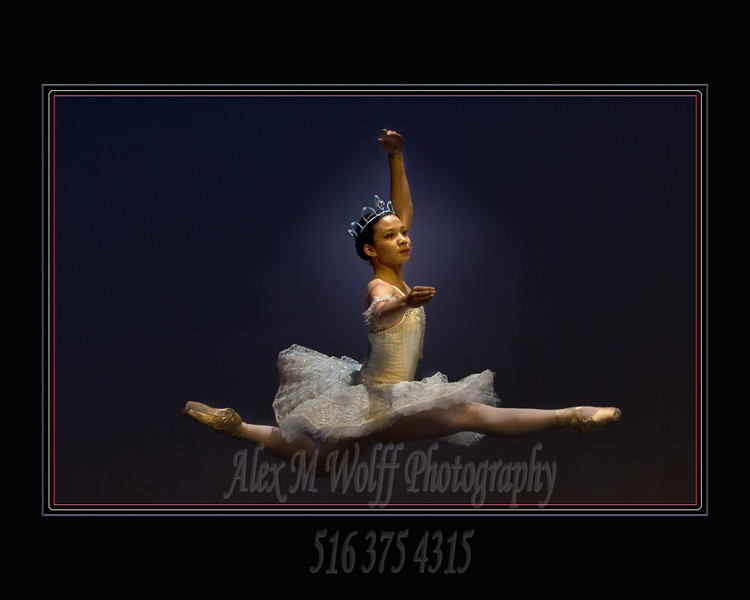 Prima Ballerina was taken during the juried Long Island Ballet Competition. No flash was allowed.  Color balance and control for stage lighting is certainly the pits.<br /> <br /> K - beauty of digital - shooting with a d300 and 70  -200 VR at 1000 ISO  exp set manually to 1/400th at 2.8 ( I walked and mapped the stage lighting with a meter before the competition began), manual focus, lens supported on my knee - little bit of blur on the leading leg. This particular leap was more upward than forward motion.  I saw the routine during warmups. She performed it 2x during the weekend. For the tiniest moment she hovered with amost no forward, up or downward momentum.  I would never have made the capture on film, on my d70 or d2x (too much noise).
