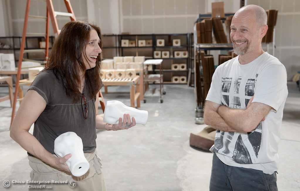 . Alex Marshall at left and  Andrew Barry discuss some ideas for a ceramic piece at Alex Marshall Studios on Nelson Street in Chico, Calif. Thurs. May 24, 2018. (Bill Husa -- Enterprise-Record)