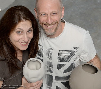 Alex Marshall and her husband Andrew Barry smile with some of their ceramics at Alex Marshall Studios on Nelson Street in Chico, Calif. Thurs. May 24, 2018. (Bill Husa -- Enterprise-Record)