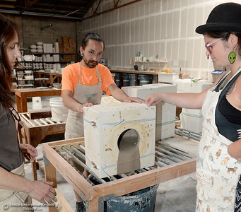 """Left to right, Alex Marshall, Studio Assistant Ryan Ramos and Production Manager in training Kirsten Springer AKA """"Ze Treasure Troll"""" dump out a mold at Alex Marshall Studios on Nelson Street in Chico, Calif. Thurs. May 24, 2018. (Bill Husa -- Enterprise-Record)"""
