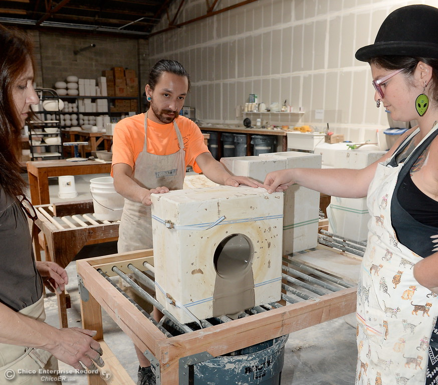 ". Left to right, Alex Marshall, Studio Assistant Ryan Ramos and Production Manager in training Kirsten Springer AKA ""Ze Treasure Troll\"" dump out a mold at Alex Marshall Studios on Nelson Street in Chico, Calif. Thurs. May 24, 2018. (Bill Husa -- Enterprise-Record)"