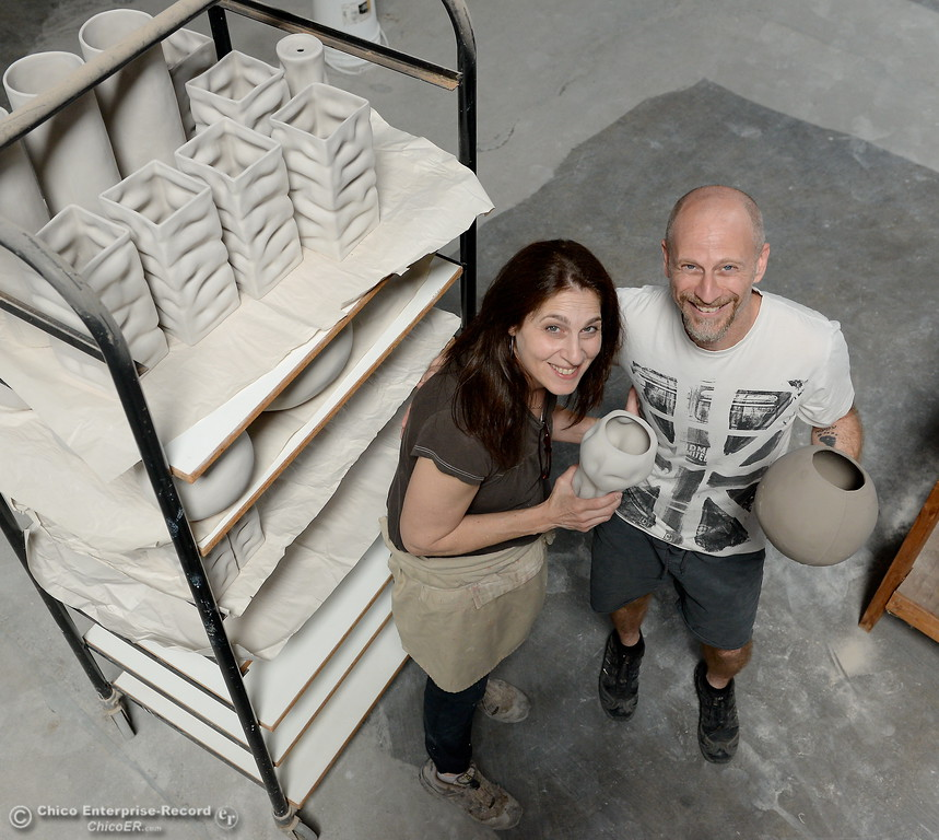 . Alex Marshall and her husband Andrew Barry smile with some of their ceramics at Alex Marshall Studios on Nelson Street in Chico, Calif. Thurs. May 24, 2018. (Bill Husa -- Enterprise-Record)