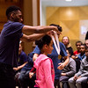 Actor Titus VanHook awards third grade playwright Naviae Raheem an honorable mention medal during the Young Playwrights Project Friday, June 14, 2019. ALEX WADLEY/STAFF PHOTOGRAPHER