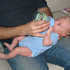At 4 weeks old Daddy gave Alex his first bottle.