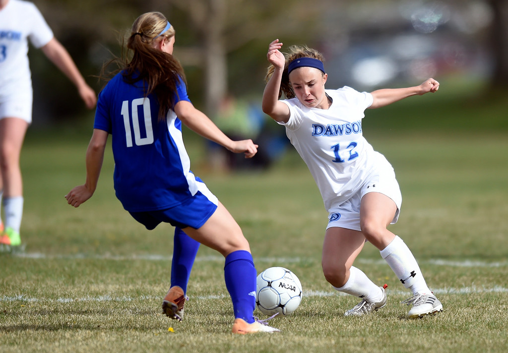 . Alexander Dawson School\'s Cameron Epstein moves the ball past McKenna Mueller during a game against Denver Christian on Thursday in Lafayette. More photos: www.BoCoPreps.com Jeremy Papasso/ Staff Photographer/ April 20, 2017