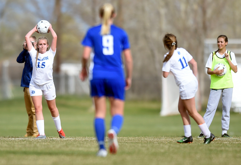. Alexander Dawson School\'s Shelby Jorgensen throws the ball inbounds during a game against Denver Christian on Thursday in Lafayette. More photos: www.BoCoPreps.com Jeremy Papasso/ Staff Photographer/ April 20, 2017