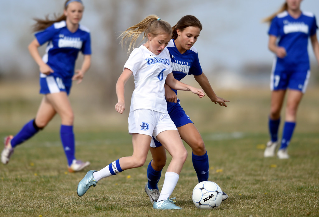 . Alexander Dawson School\'s Sage Roshko moves the ball past Kaya Schaap during a game against Denver Christian on Thursday in Lafayette. More photos: www.BoCoPreps.com Jeremy Papasso/ Staff Photographer/ April 20, 2017