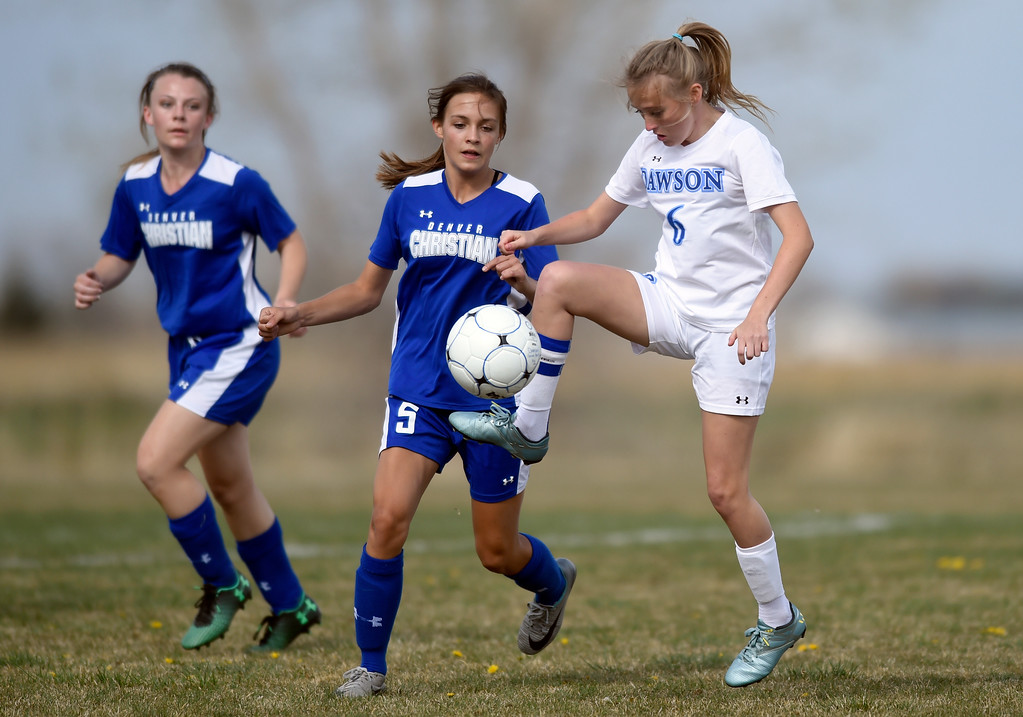 . Alexander Dawson School\'s Sage Roshko stops a pass during a game against Denver Christian on Thursday in Lafayette. More photos: www.BoCoPreps.com Jeremy Papasso/ Staff Photographer/ April 20, 2017