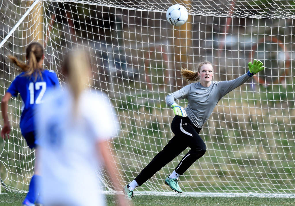 . Alexander Dawson School Goalkeeper Kate Gallop goes for a save during a game against Denver Christian on Thursday in Lafayette. More photos: www.BoCoPreps.com Jeremy Papasso/ Staff Photographer/ April 20, 2017