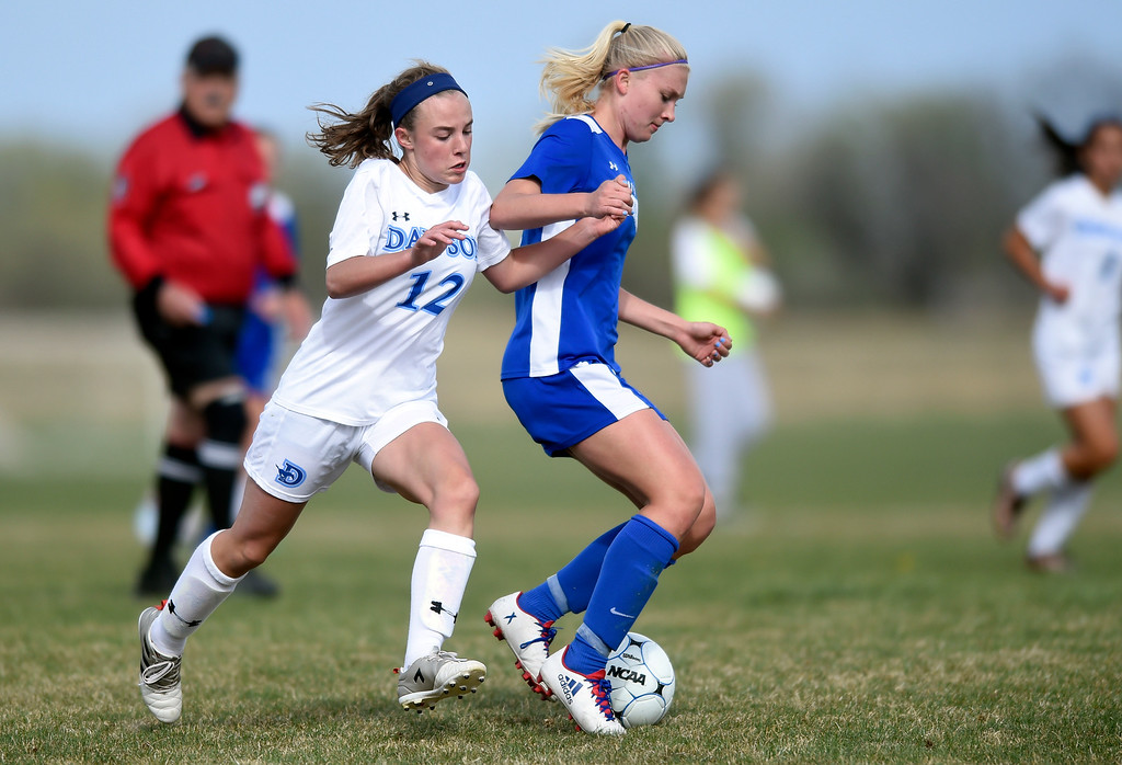 . Alexander Dawson School\'s Cameron Epstein tries to steal the ball from Miranda Kortenhoeven during a game against Denver Christian on Thursday in Lafayette. More photos: www.BoCoPreps.com Jeremy Papasso/ Staff Photographer/ April 20, 2017