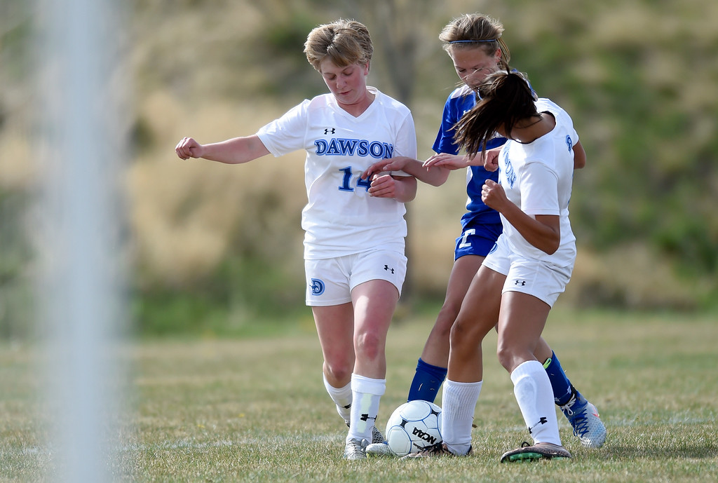 . Alexander Dawson School\'s Emily Hicks, at left, fights for the ball during a game against Denver Christian on Thursday in Lafayette. More photos: www.BoCoPreps.com Jeremy Papasso/ Staff Photographer/ April 20, 2017