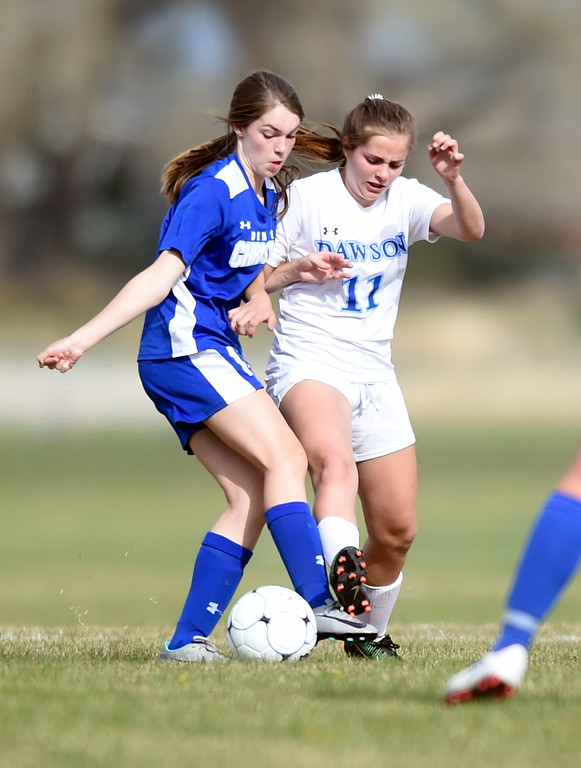 . Alexander Dawson School\'s Lily Sutherland fights for the ball with Anna Kaemingk during a game against Denver Christian on Thursday in Lafayette. More photos: www.BoCoPreps.com Jeremy Papasso/ Staff Photographer/ April 20, 2017
