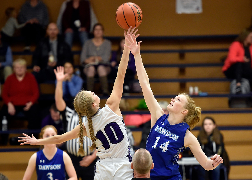 . LONGMONT, CO - JANUARY 08, 2019: Alexander Dawson\'s Kate Gallop fights for the tip-off against Sammie Johnson during a game against the Longmont Christian on Tuesday, Jan. 08, in Longmont. More photos: BoCoPreps.com (Photo by Jeremy Papasso/Staff Photographer)